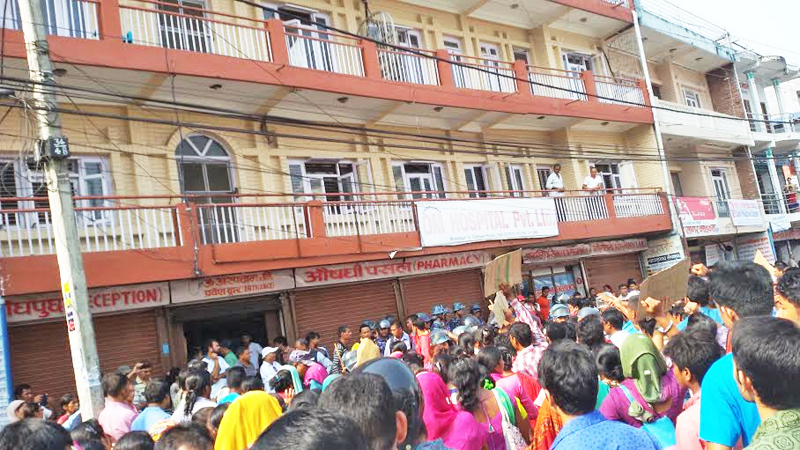 Relatives of Manju Kumari Mahato, who died during treatment at the Chitwan-based Om Hospital, chanting slogans on the hospital premises in Bharatpur of Chitwan district on Friday, September 11, 2015. Photo: Tilak Rimal